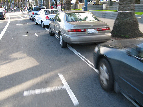 A short lived failed attempt to do off-set parking as a faux bike lane barrier.  Via Richard Masoner