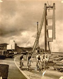 Bicyclists on the Golden Gate Bridge before opening in 1932. Via SAN FRANCISCO HISTORY CENTER, SAN FRANCISCO PUBLIC LIBRARY